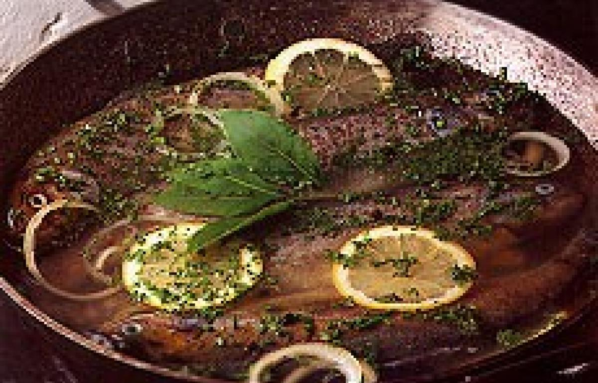 A picture of Delia's Poached Trout with Herbs recipe