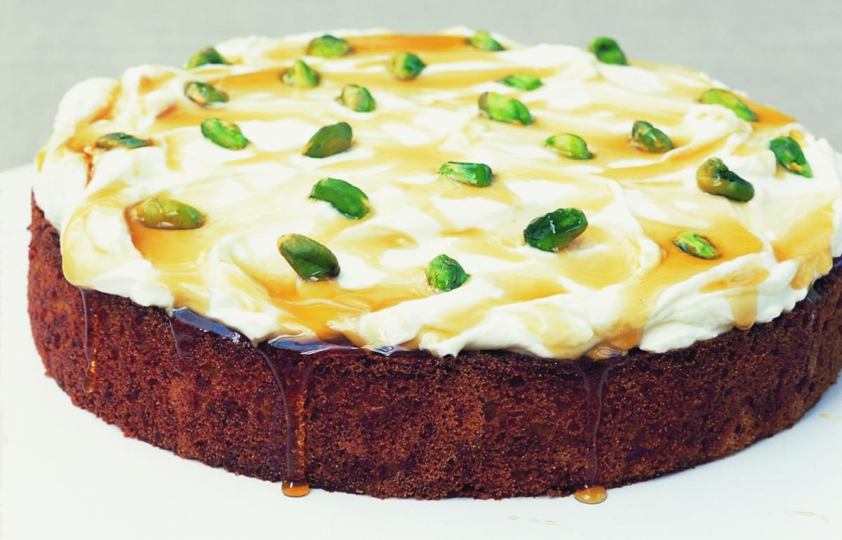 Baking greek orange and honey syrup cake with yoghurt and pistachios