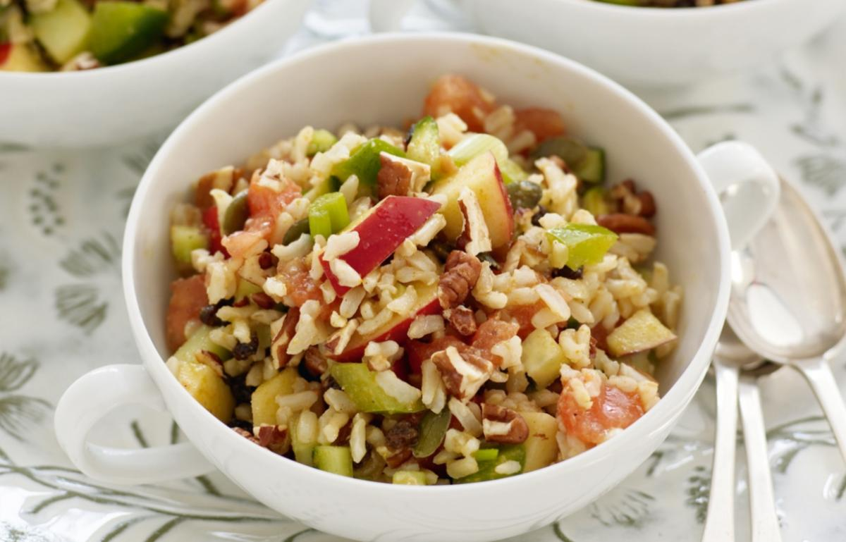 Happy spiced brown rice salad with nuts and seeds