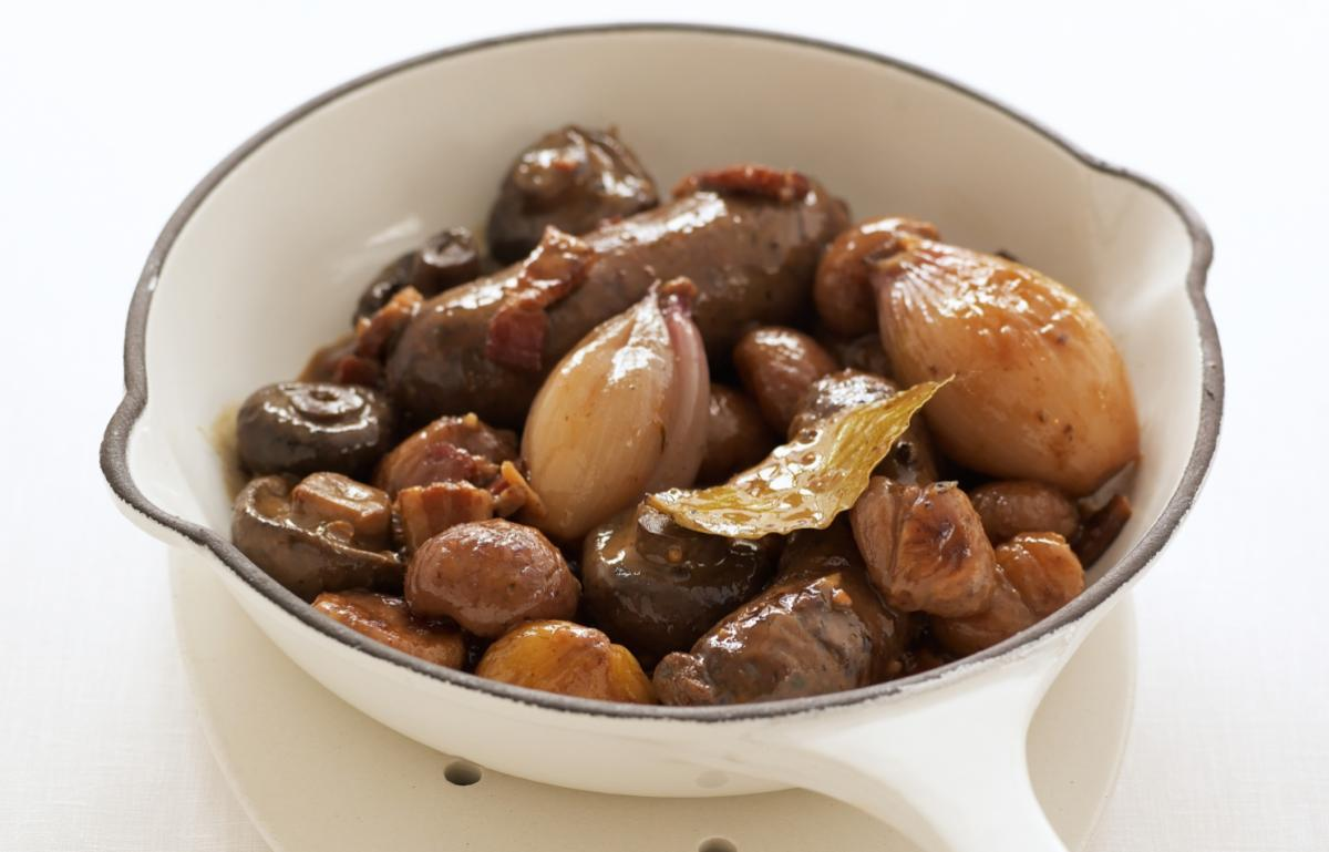 Happy venison sausages braised in white wine with caramelised chestnuts