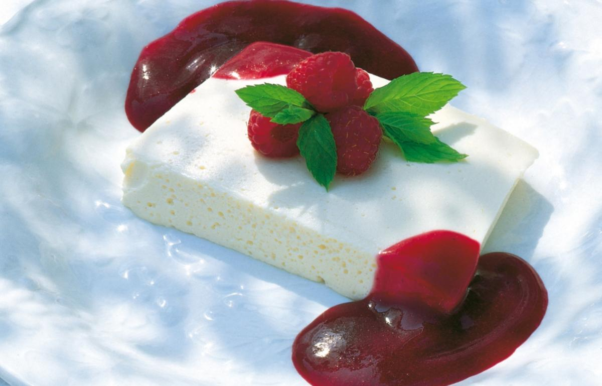 Summer vanilla cream terrine with raspberries and blackcurrant coulis