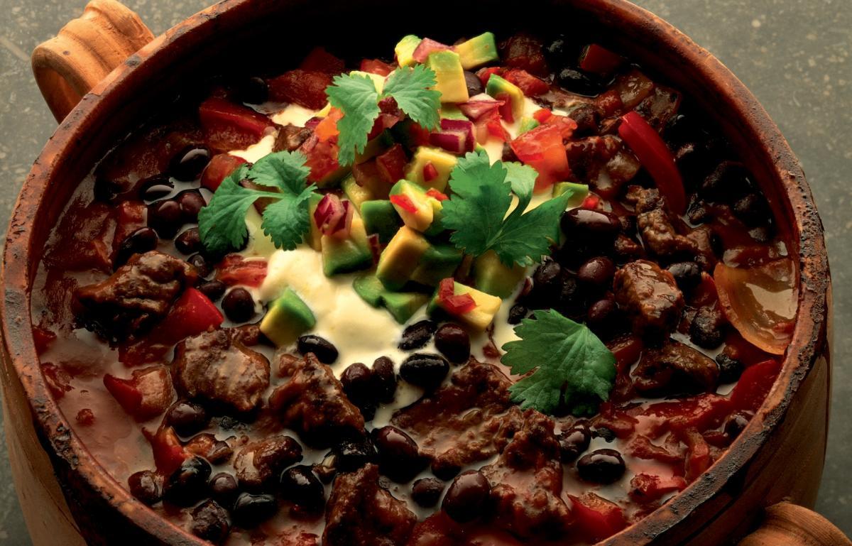 Winter black bean chilli with avocado salsa