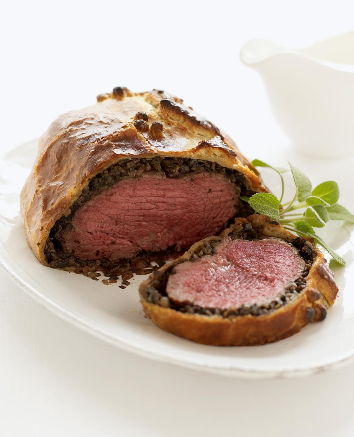 Happy fillet of beef in pastry with wild mushrooms and red wine sauce