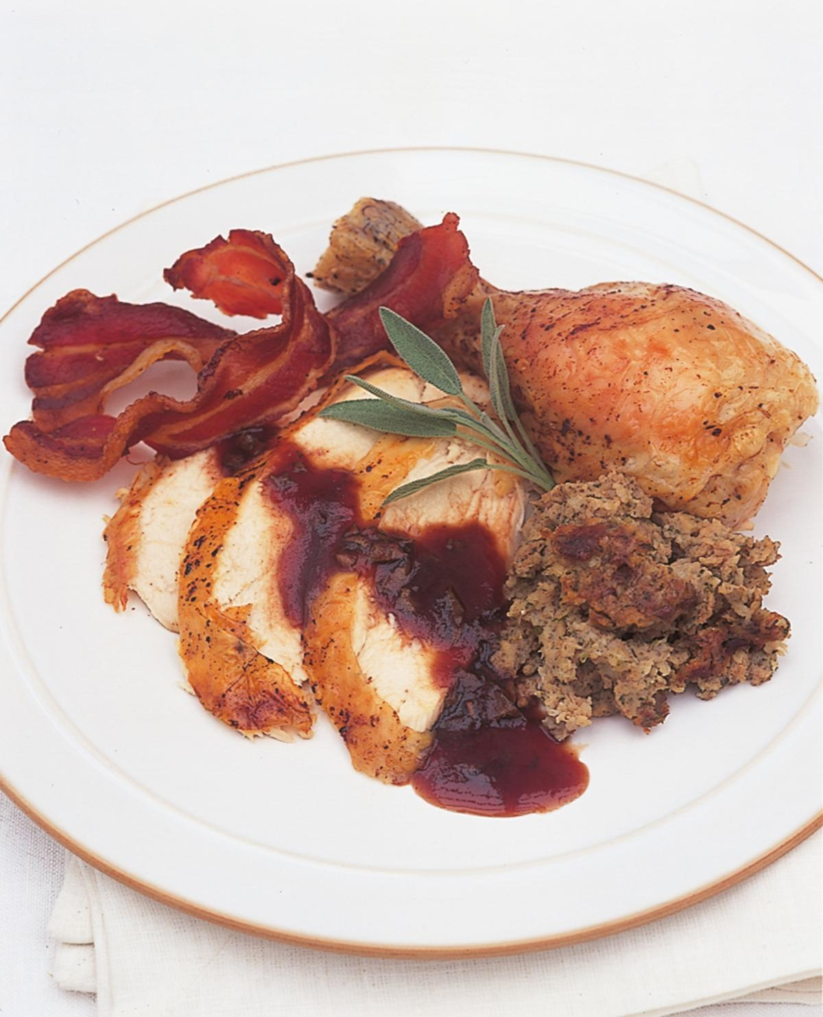 Htc traditional roast chicken with apple sage and onion stuffing cranberry and sage sauce and chicken giblet gravy version1