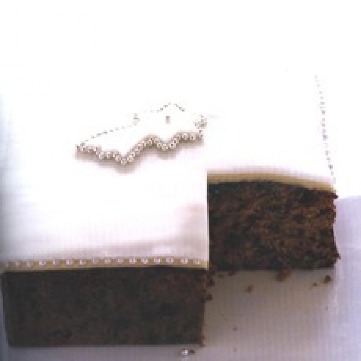 A picture of Delia's Decorating the Prune and Armagnac Creole Cake recipe