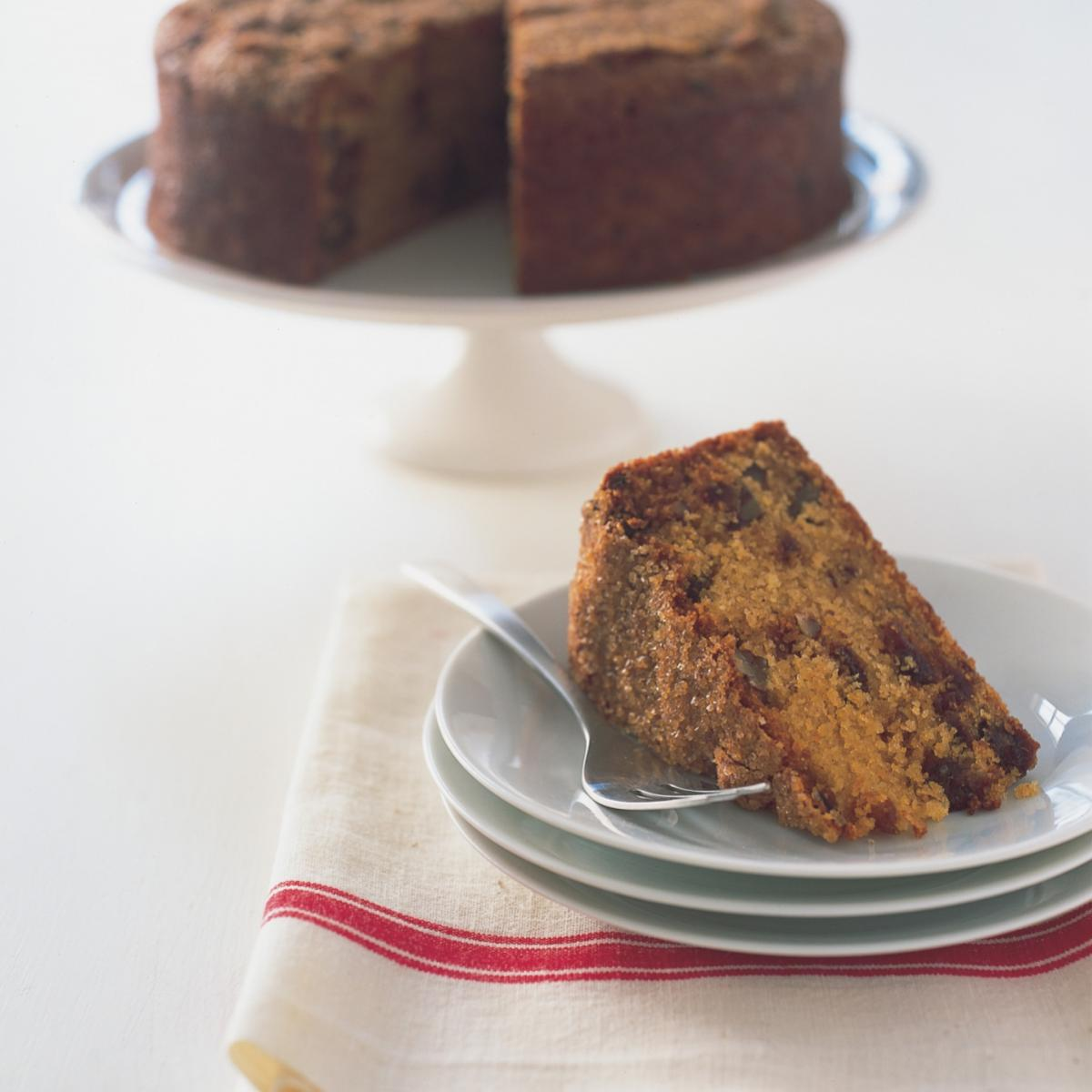 Baking polenta and ricotta cake with dates and pecans