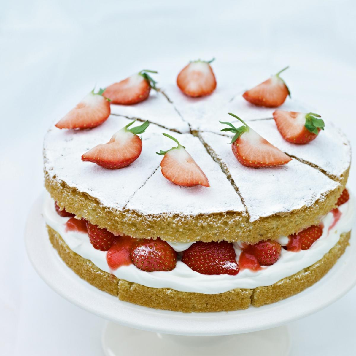 Cakes strawberries and cream sponge cake