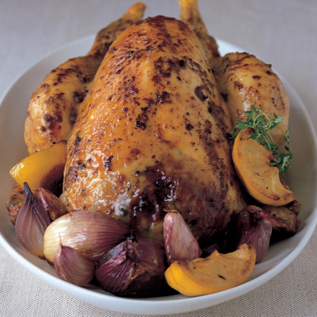 Chicken chicken with roasted lemons red onion thyme and garlic