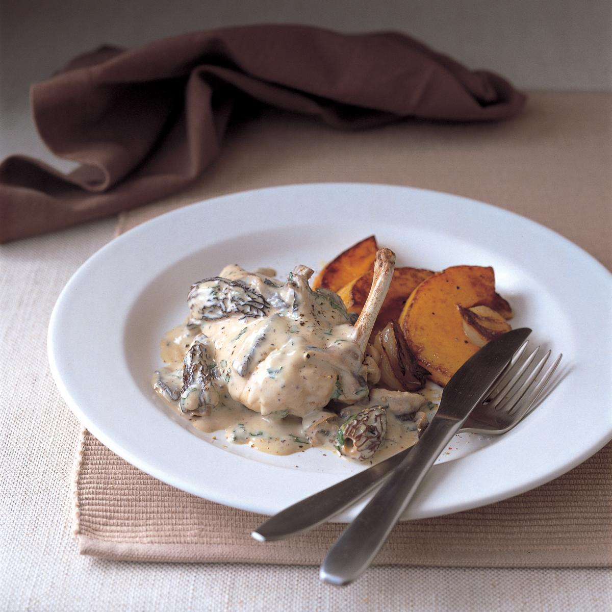 Chicken poached chicken breasts with morel mushrooms cream and parsley