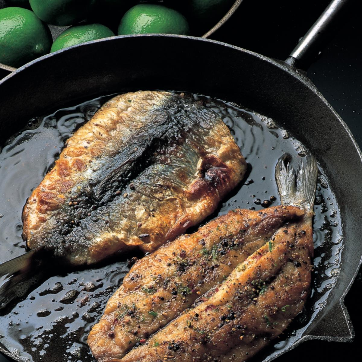 Fish fried herring fillets with a lime pepper crust