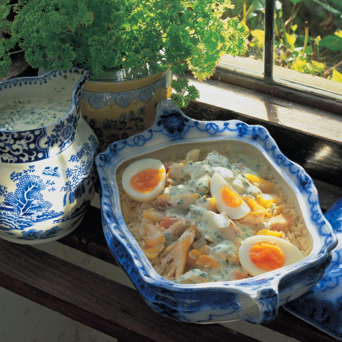 Fish mixed smoked fish kedgeree with a creme fraiche and parsley sauce