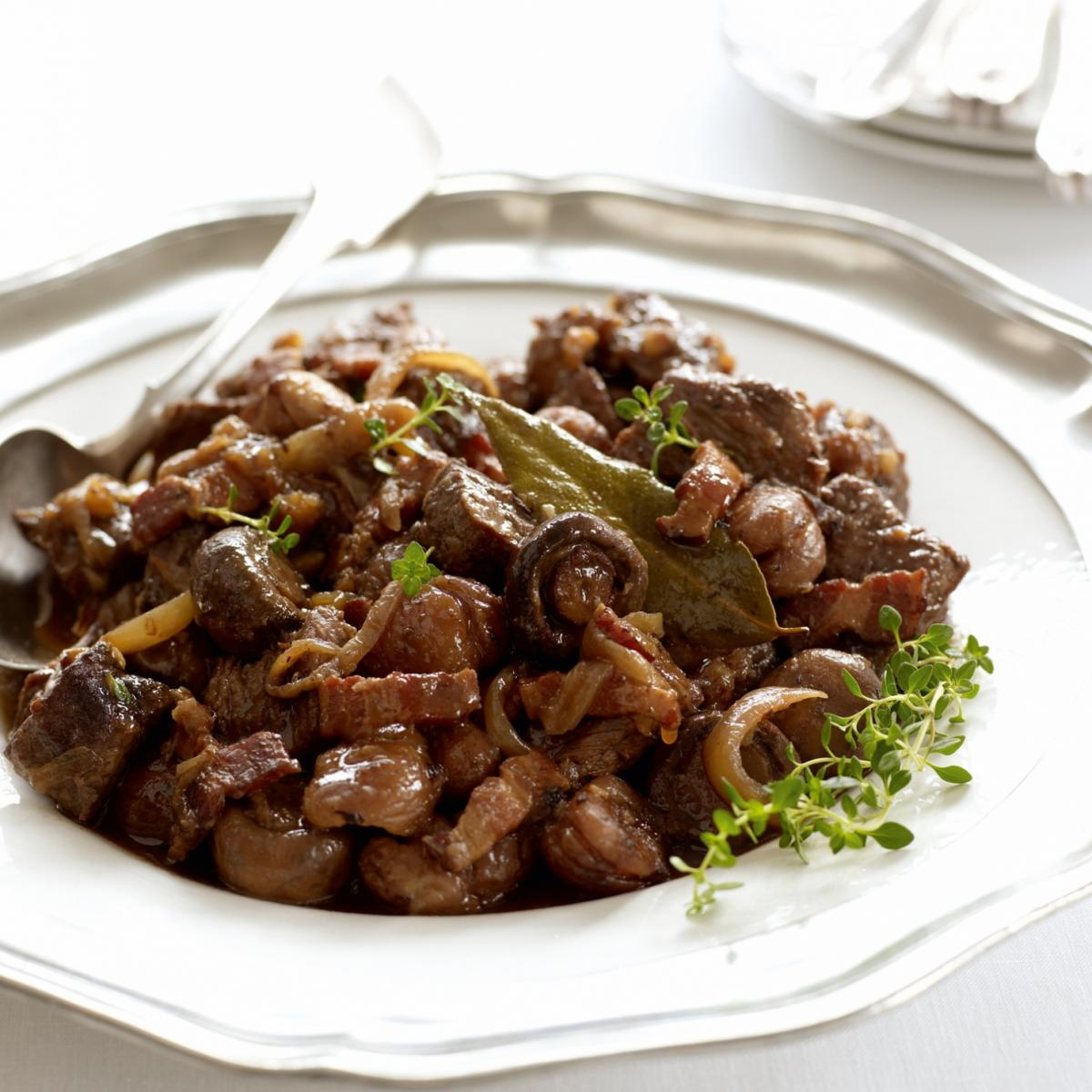 Happy braised venison with bacon chestnuts and wild mushrooms in a rich maderia sauce