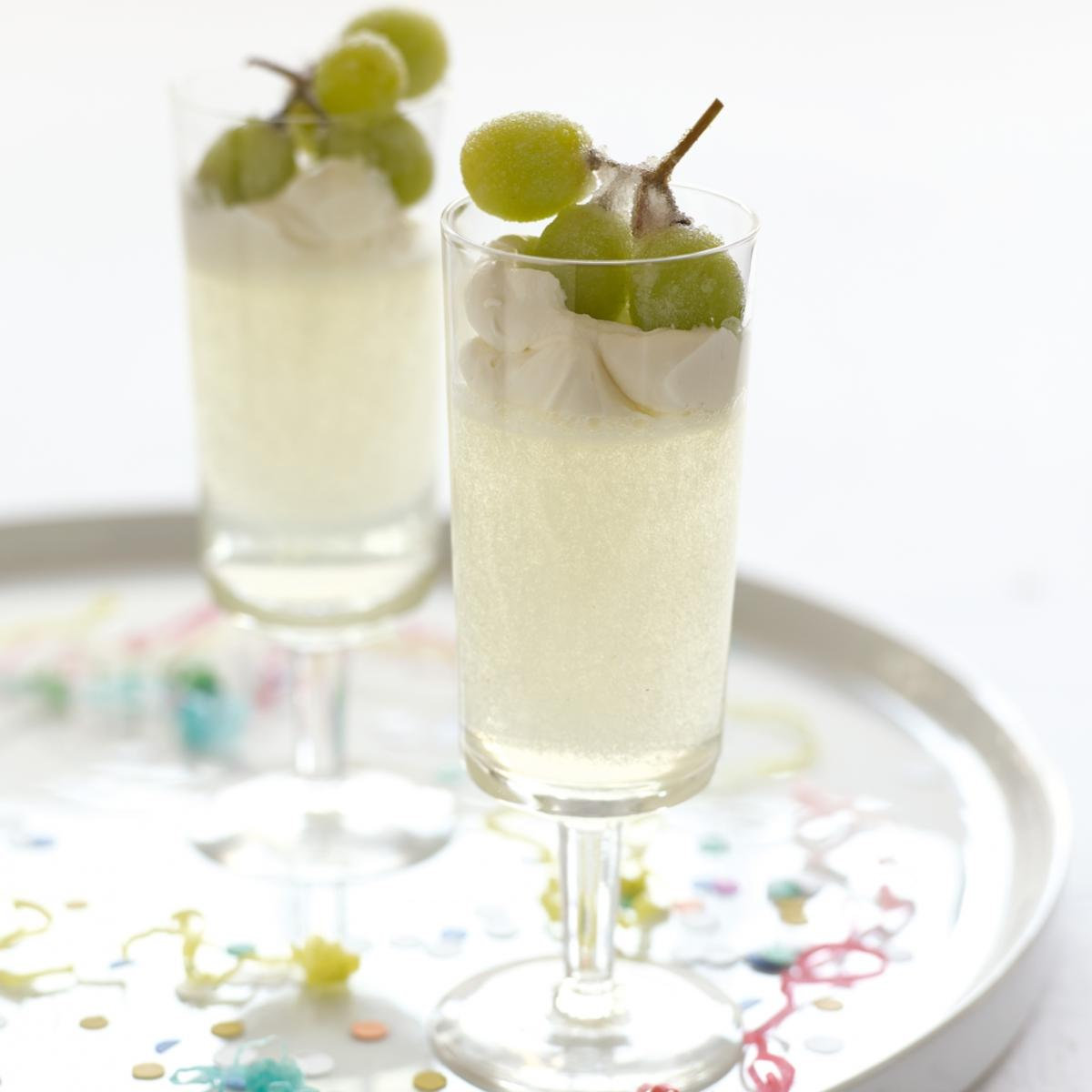 Happy champagne jellies with syllabub and frosted grapes