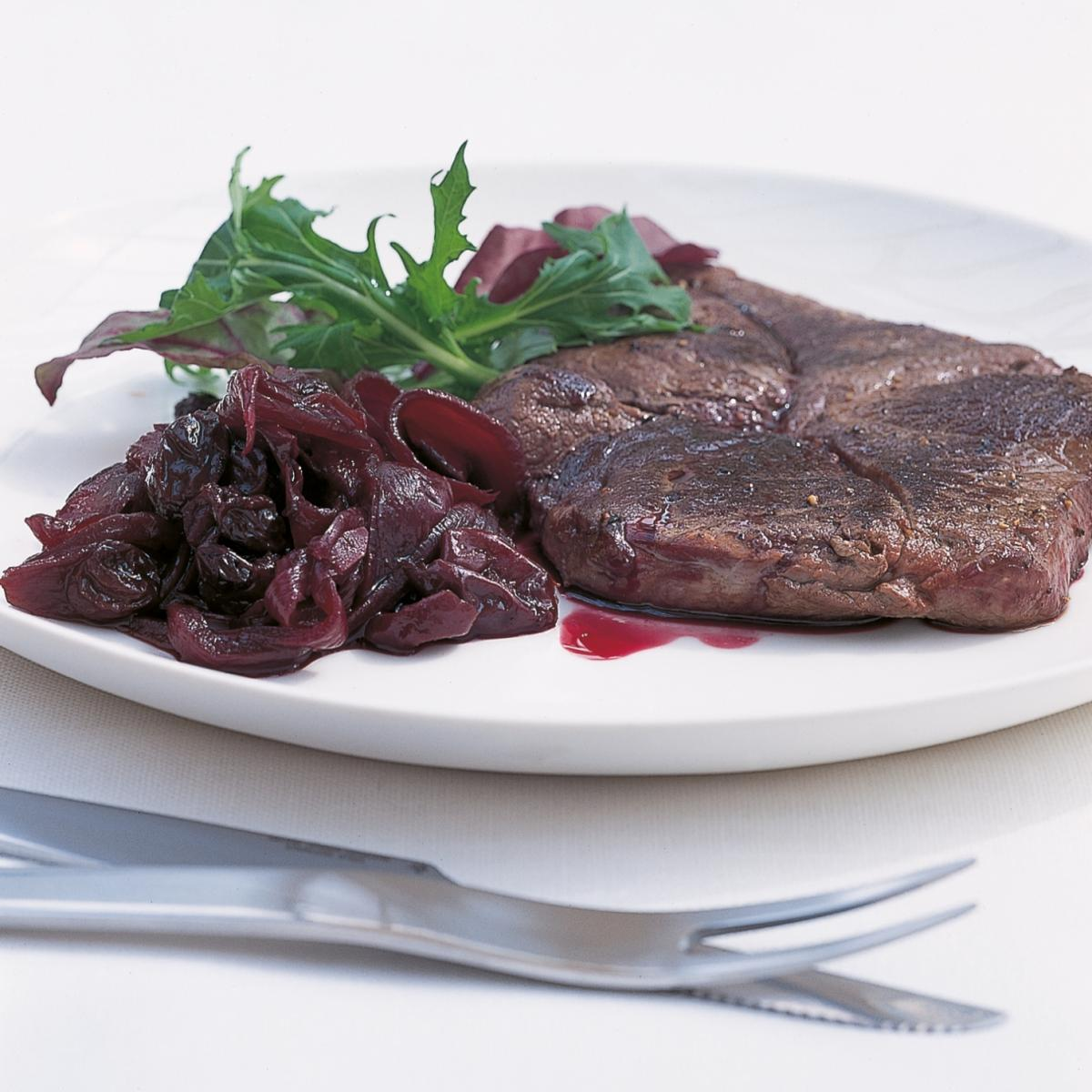 Htc grilled venison steaks with red onion grape and raisin confit