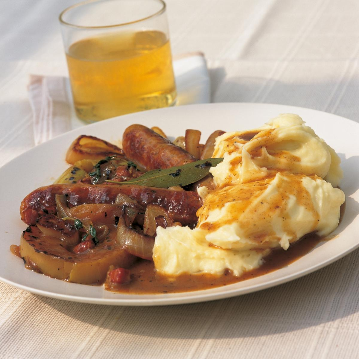 A picture of Delia's Pork Sausages Braised in Cider with Apples and Juniper recipe