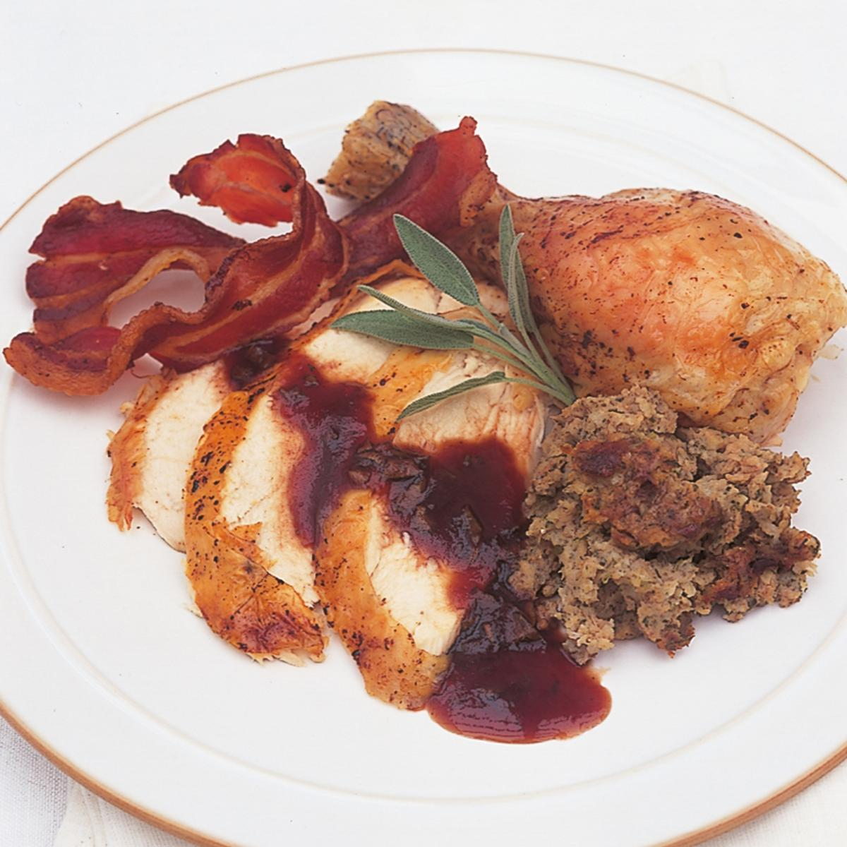 A picture of Delia's Traditional Roast Chicken with Apple, Sage and Onion Stuffing, Cranberry and Sage Sauce and Chicken-giblet Gravy recipe