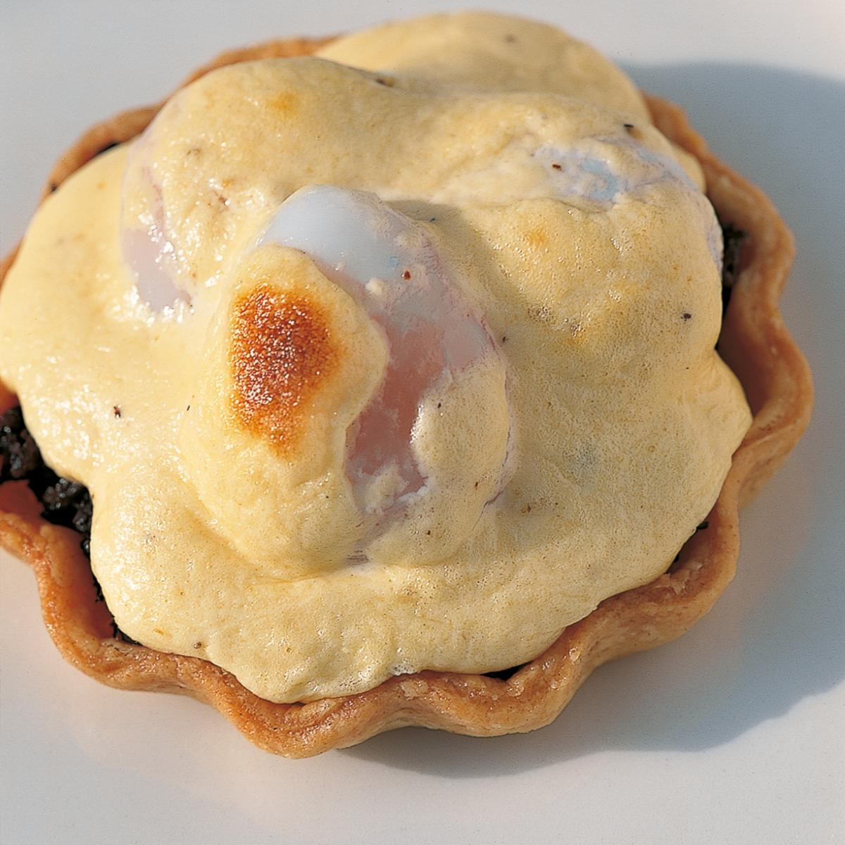 A picture of Delia's Wild Mushroom Tartlets with Poached Quails' Eggs recipe