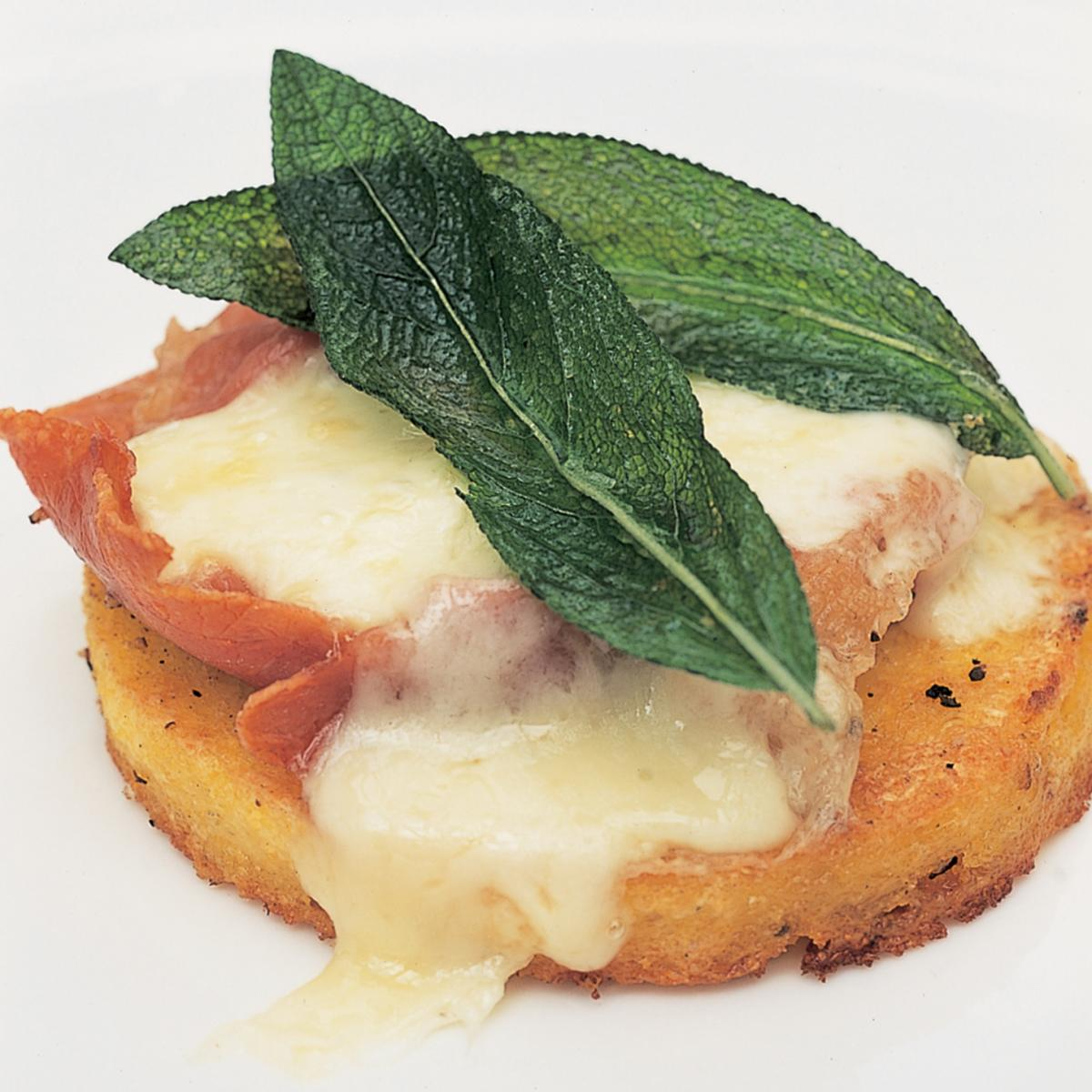 Italian grilled polenta with ham melted fontina and sage