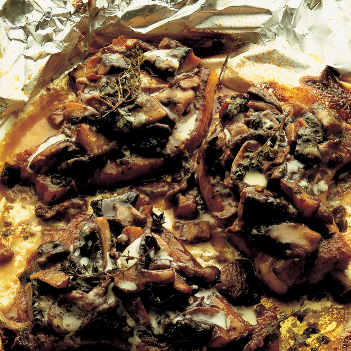 Pork pork chops baked with wild mushrooms and creme fraiche