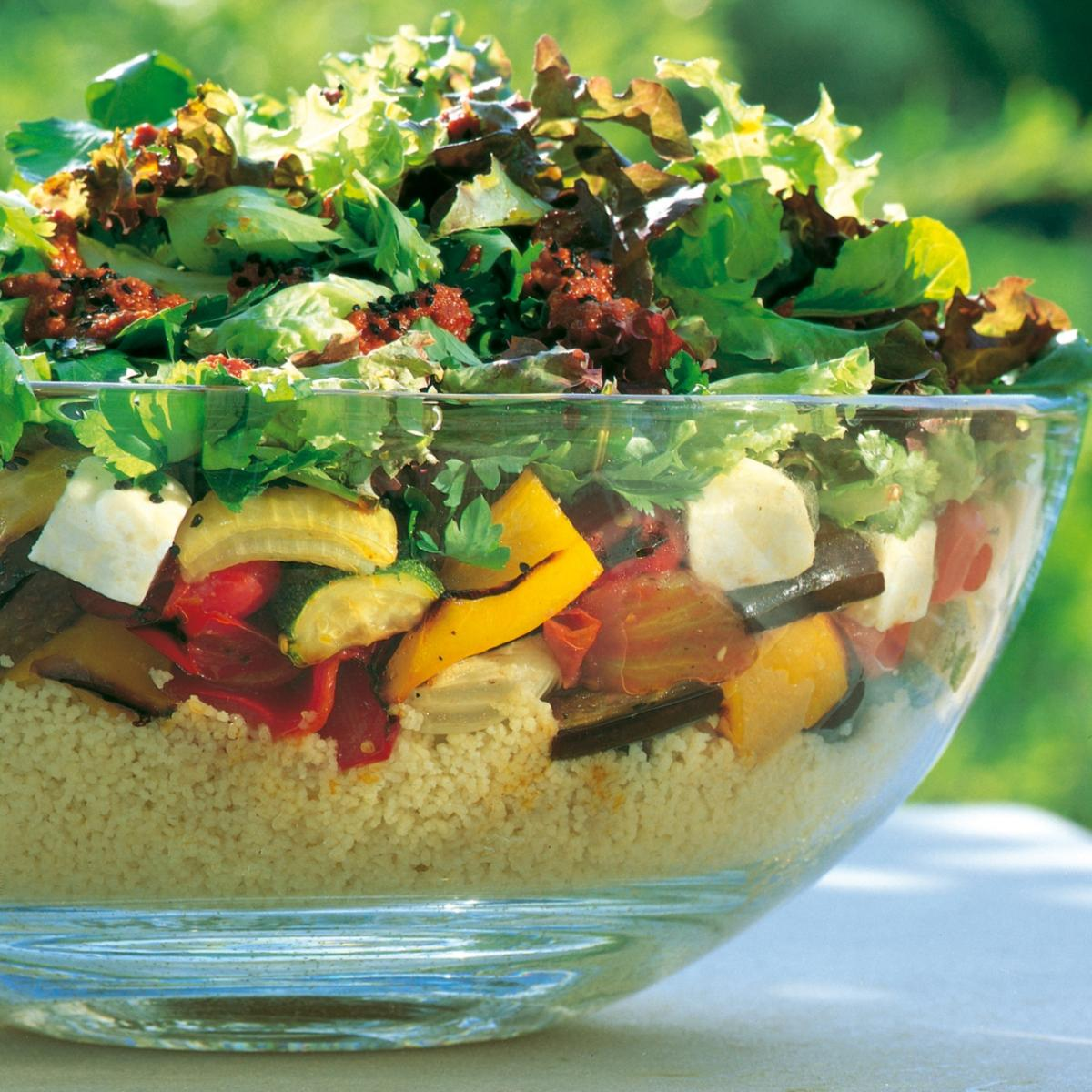 Summer roasted vegetable cous cous salad with harissa style dressing