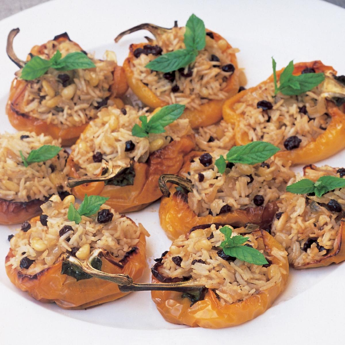 A picture of Delia's Stuffed Yellow Peppers with Pilau Rice, Currants and Toasted Pine Nuts recipe