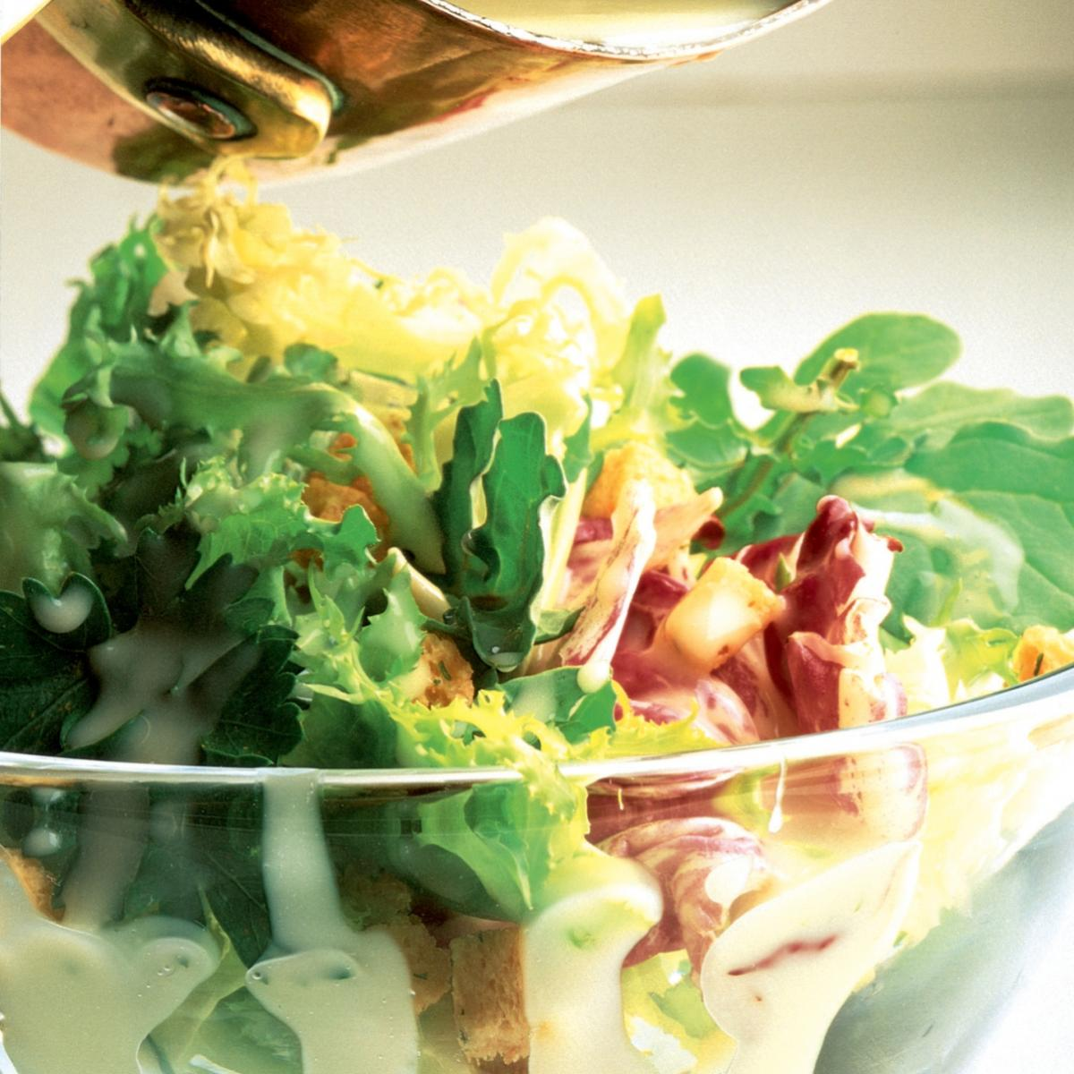 Winter apple cider salad with melted camembert dressing